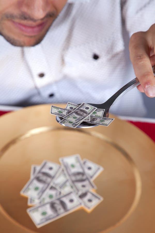 Man eating little dollar banknote