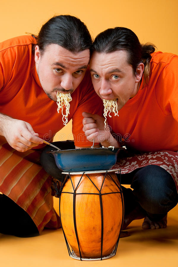 Man eating noodles stock photos
