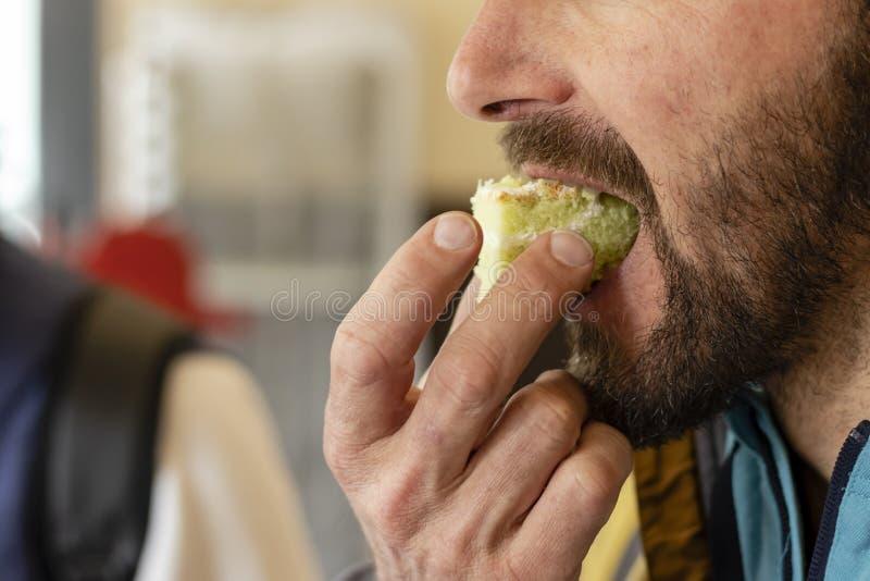 Man eating piece of cake close-up stock photos
