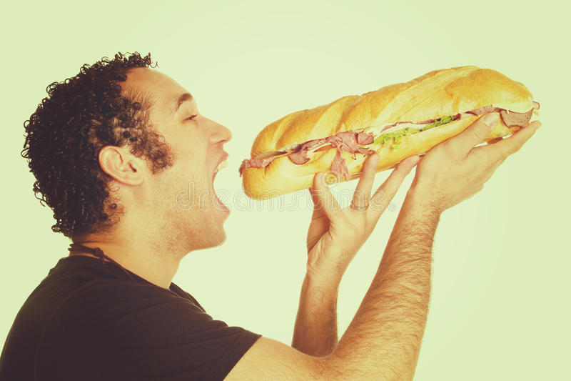 Man Eating Sandwich royalty free stock photo