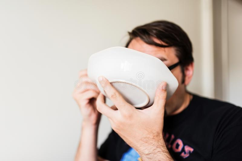 Man eating soup stock photography