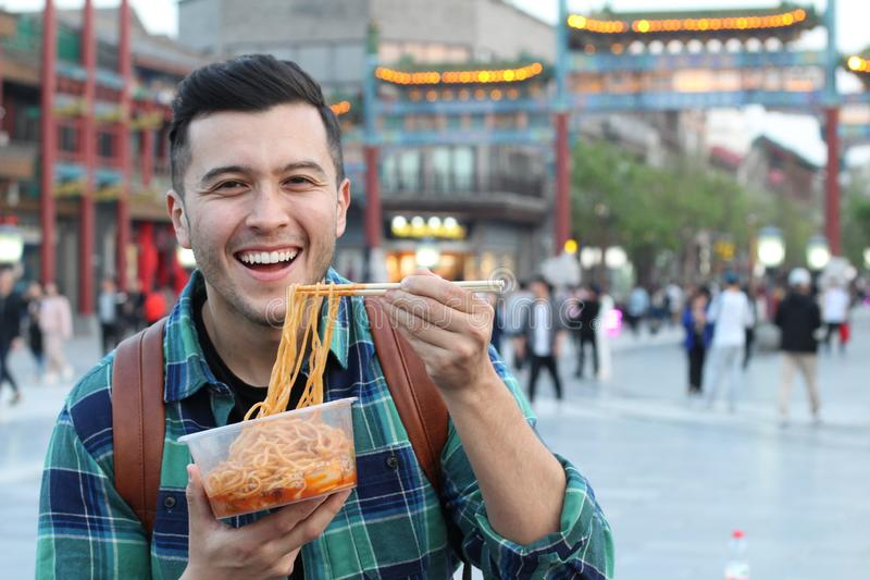Man eating street food in Asia.  royalty free stock photos