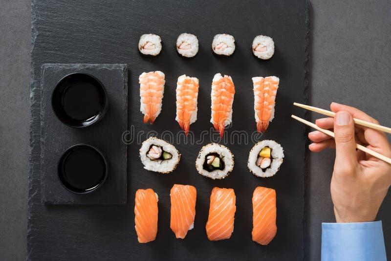 man eating sushi stock photo image of japanese chopstick. Black Bedroom Furniture Sets. Home Design Ideas