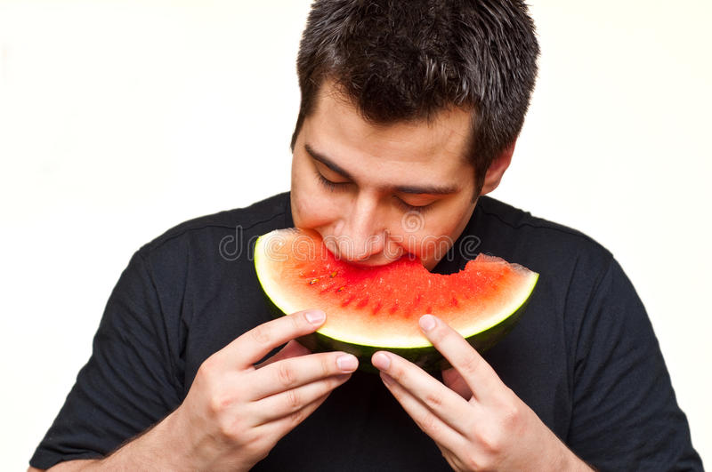 Download Man eating watermelon stock photo. Image of sliced, eating - 14823610