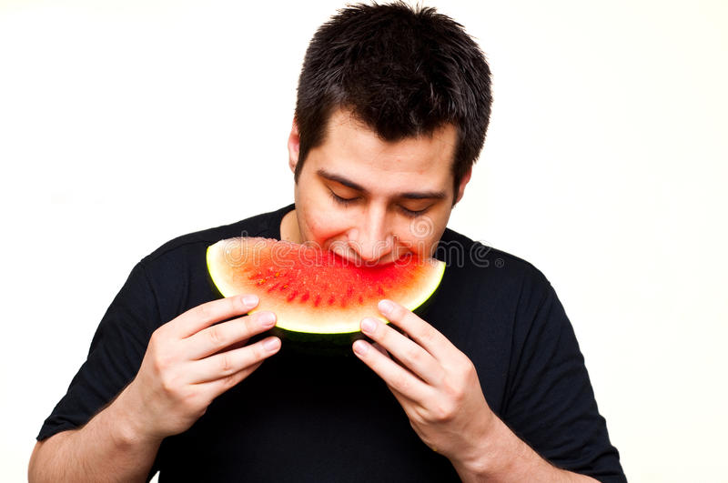 Download Man eating watermelon stock photo. Image of round, cool - 14823642