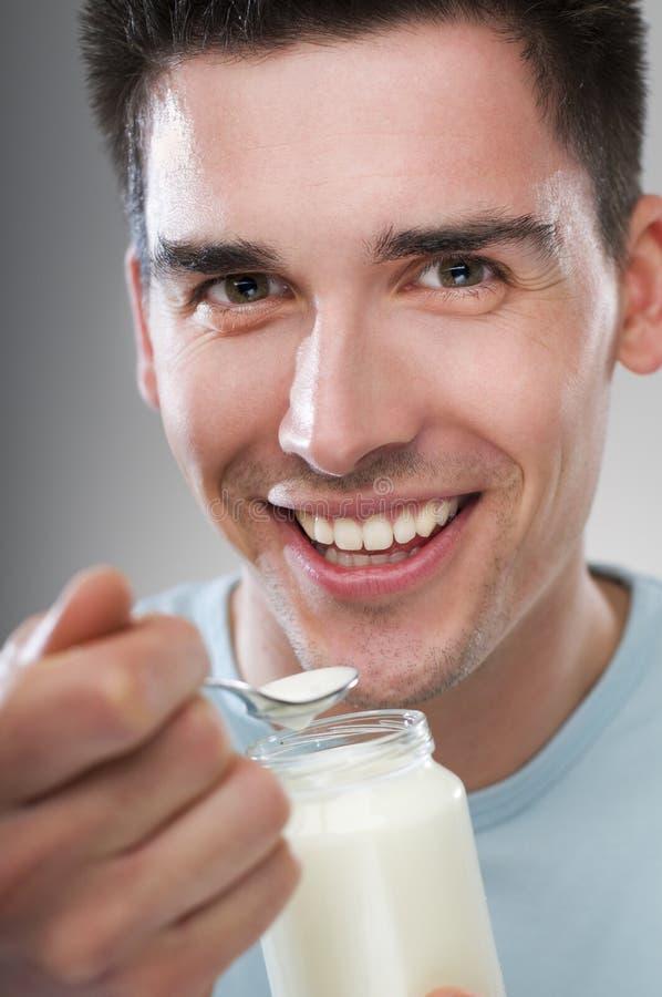 Man eating yogurt stock photos