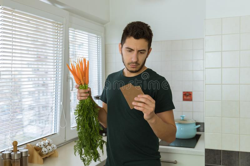 Man eats chocolate with great pleasure. The concept of proper nutrition. Man eats chocolate with great pleasure. He does not want to eat vegetables royalty free stock photography