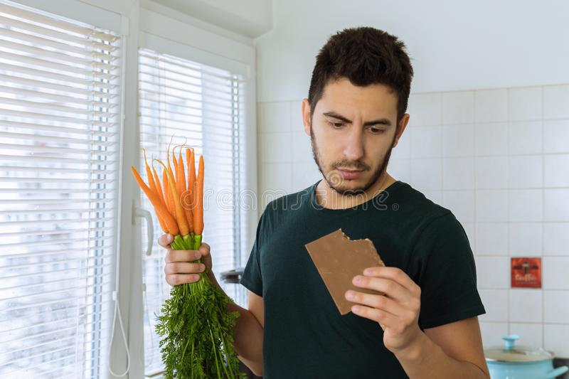 Man eats chocolate with great pleasure. The concept of proper nutrition. stock photography