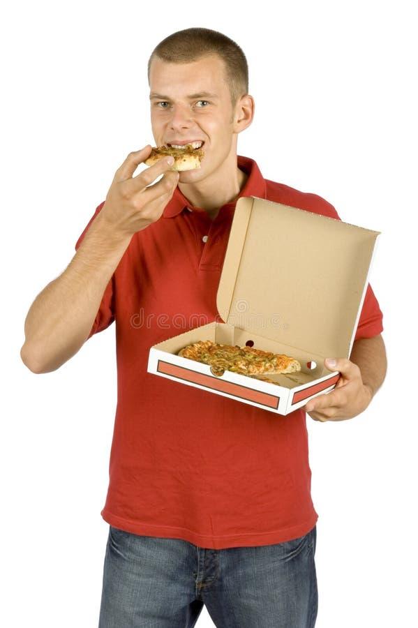 Man eats pizza stock photo