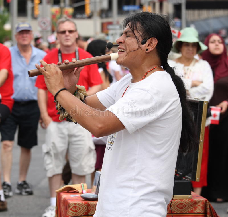 Man from Ecuador  Playing Flute