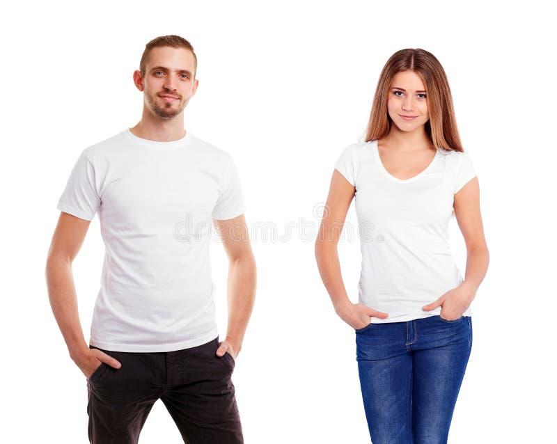 Man een vrouw in lege witte die t-shirt, op witte achtergrond wordt geïsoleerd royalty-vrije stock foto