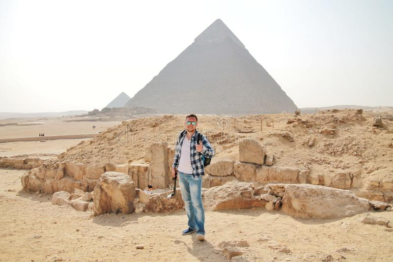 Man with Egypt pyramids view royalty free stock image