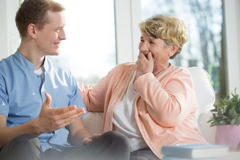Man and elderly woman laughing stock image