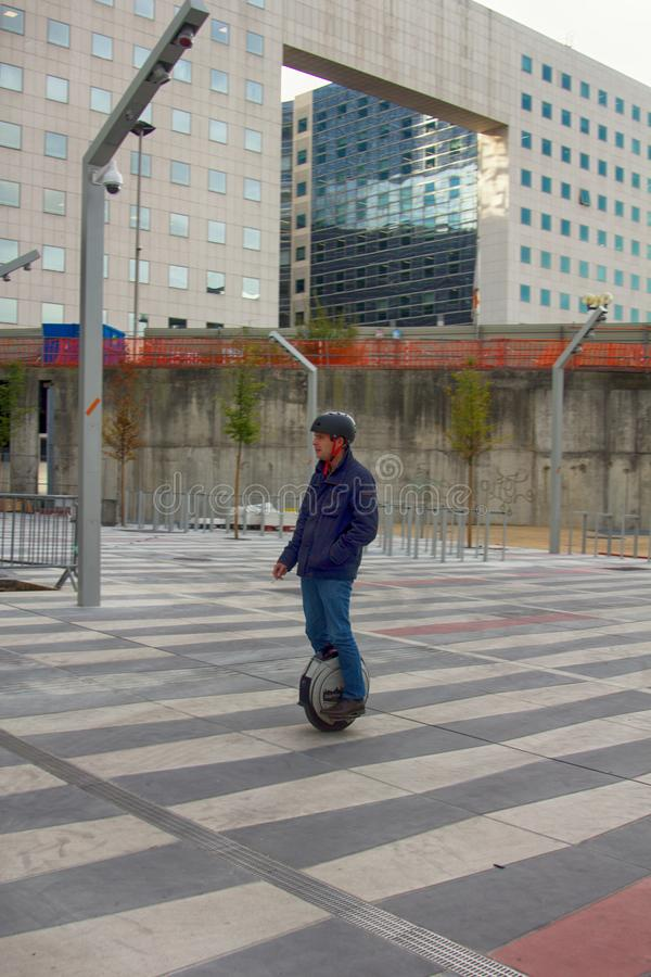 man on electric wheel in the new district of Paris. stock photography