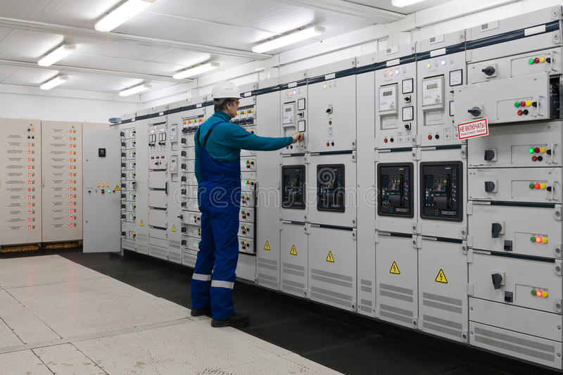 Man is in electrical energy distribution substation royalty free stock photo