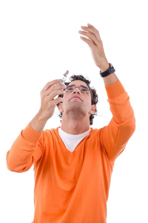 Man electrician placing light bulb stock photography