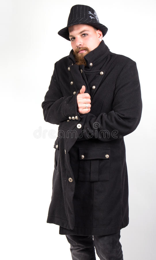 Man with elegant coat. Dressed in black stock images