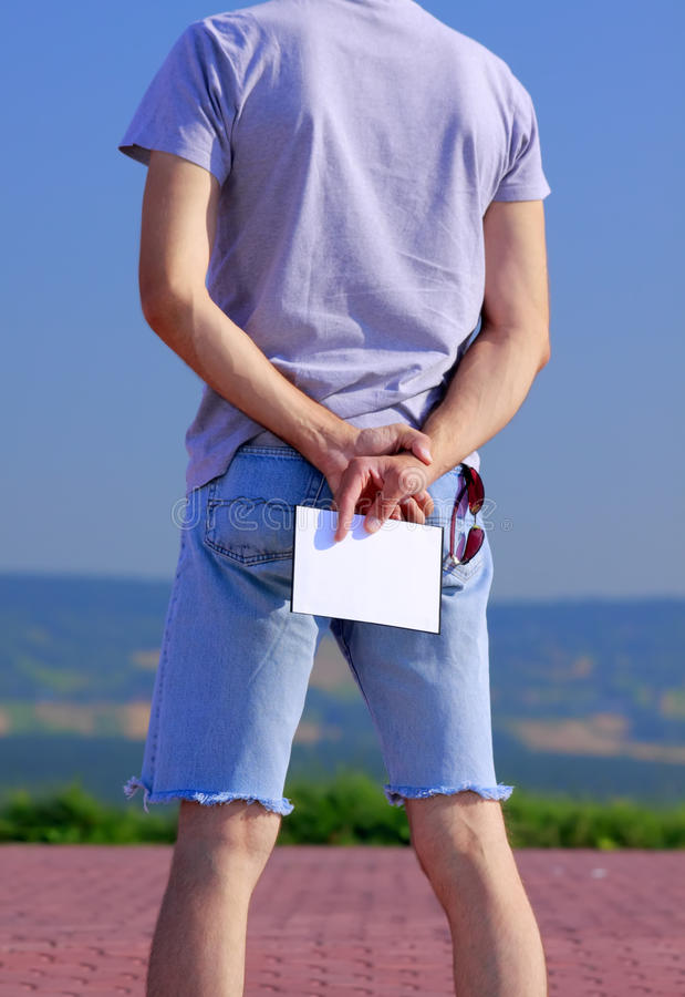 Man with empty card stock photography