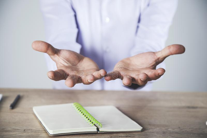 Man empty hand with notepad royalty free stock photography