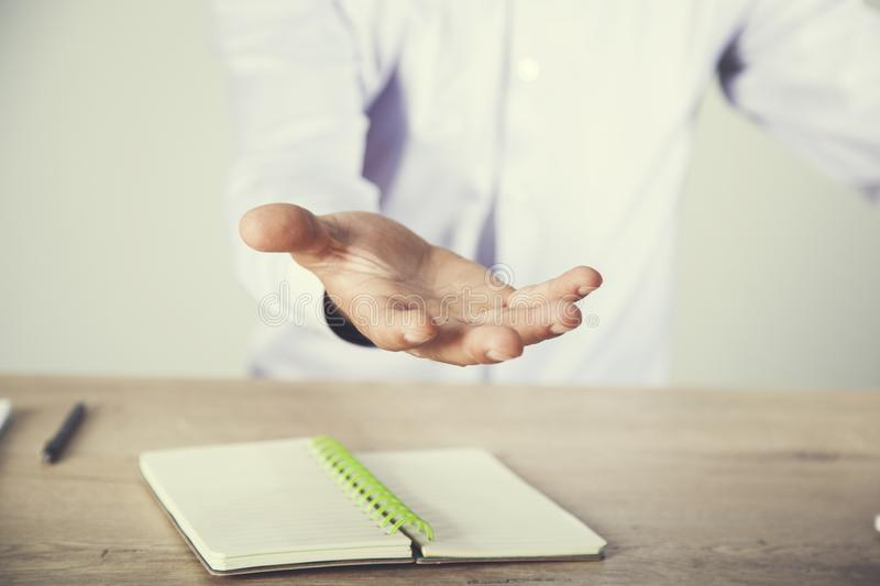Man empty hand with notepad royalty free stock photos