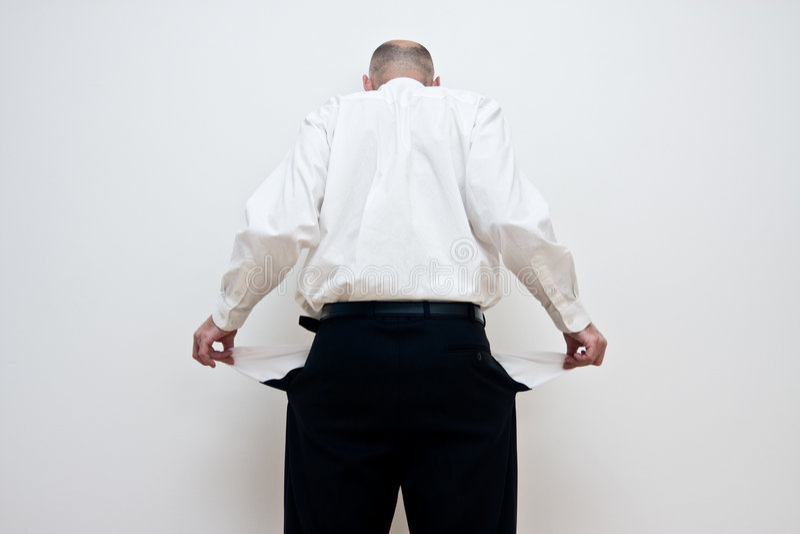 Man with empty pockets royalty free stock photo