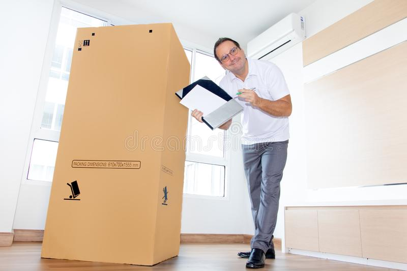 A man in an empty room shows a blank paper stock image