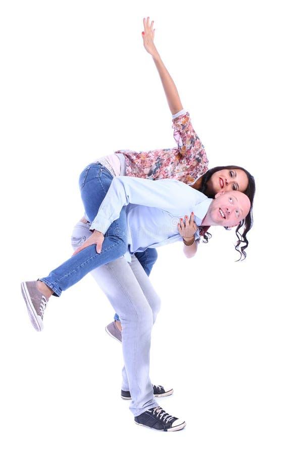 Man en vrouw die van erachter over wit gluren stock afbeeldingen
