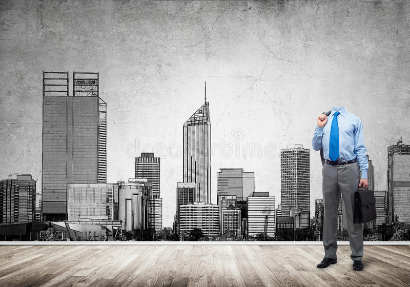 Man of engineering profession. Headless engineer man with papers in hand against construction background royalty free stock photo