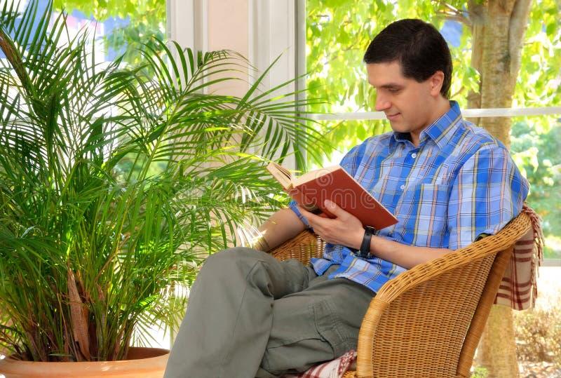 Man Enjoying A Book At Home Royalty Free Stock Image