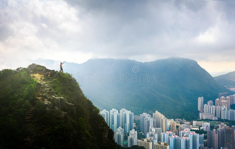 Man enjoying fogy Hong Kong view from the Lion rock royalty free stock image