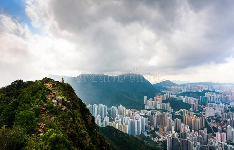 Man enjoying fogy Hong Kong view from the Lion rock royalty free stock photography