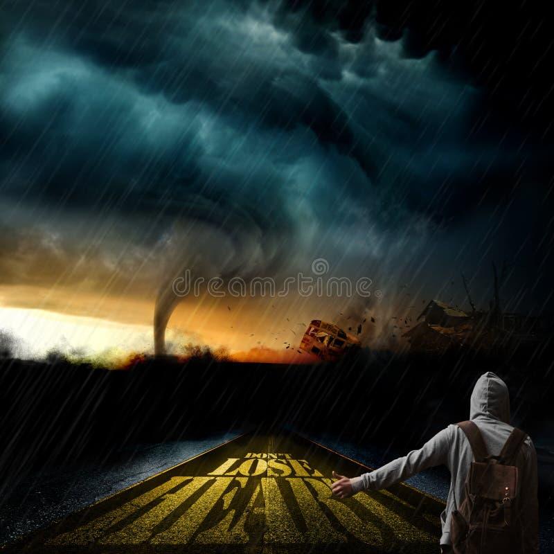 Boy A boy with a hooded sweatshirt hitchhiking into a tornado. A boy with a hooded sweatshirt hitchhiking into a tornado royalty free stock photography