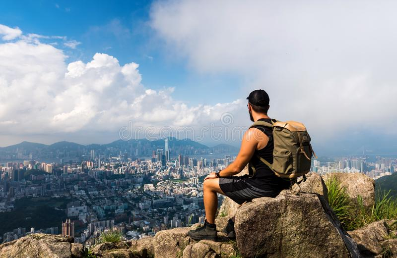 Man enjoying Hong Kong view from the Lion rock royalty free stock photography