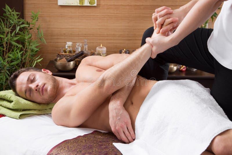 Man enjoying massage in salon royalty free stock photography