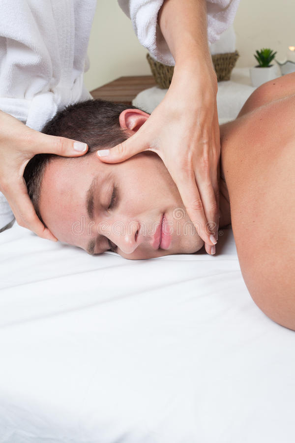 Man enjoying a massage royalty free stock image