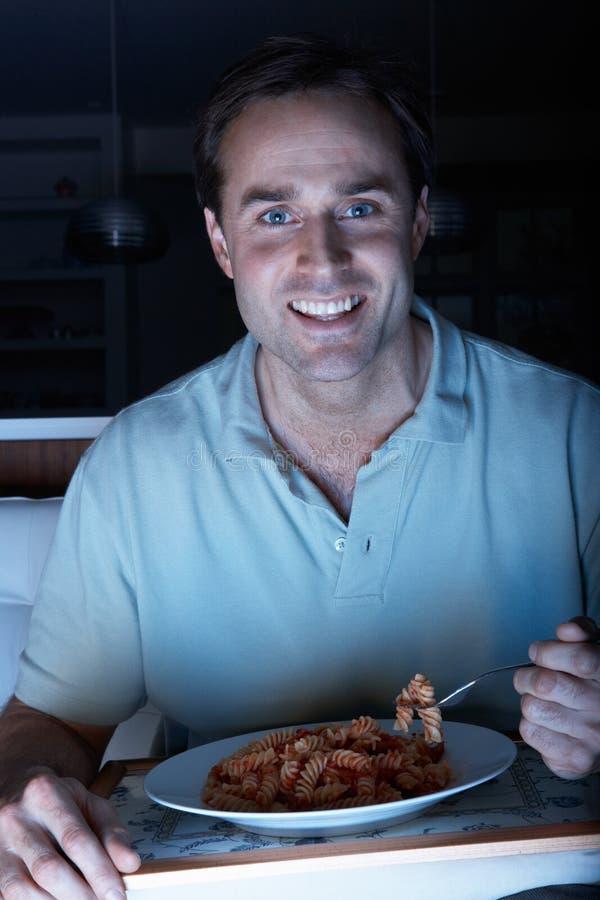 Download Man Enjoying Meal Whilst Watching TV Stock Image - Image: 18746249