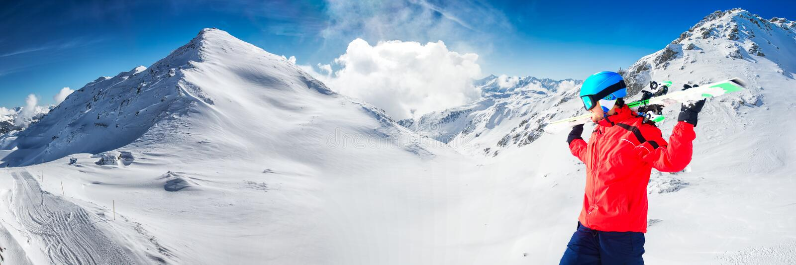 Man enjoying the stunning view before skiing in famous ski resort in Alps stock photography