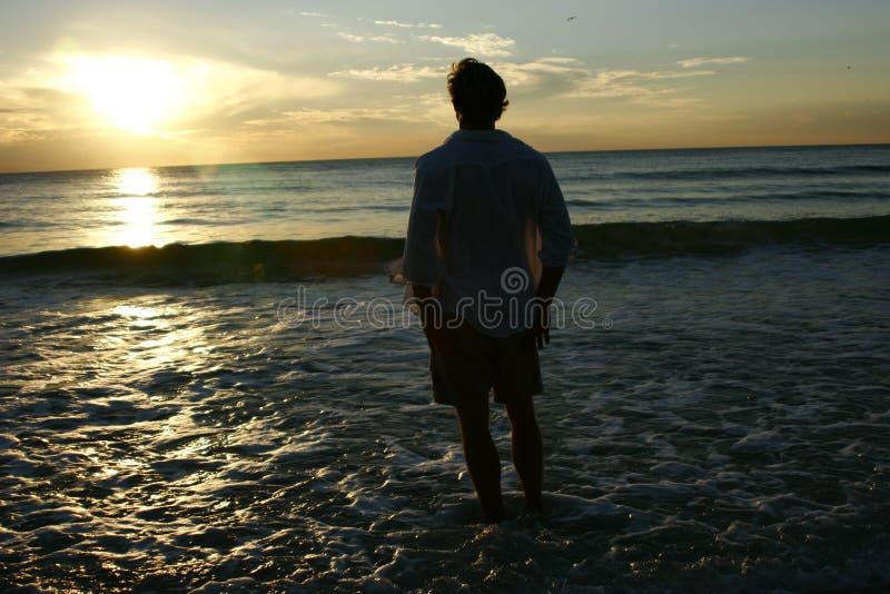 Man enjoying sunset stock photos