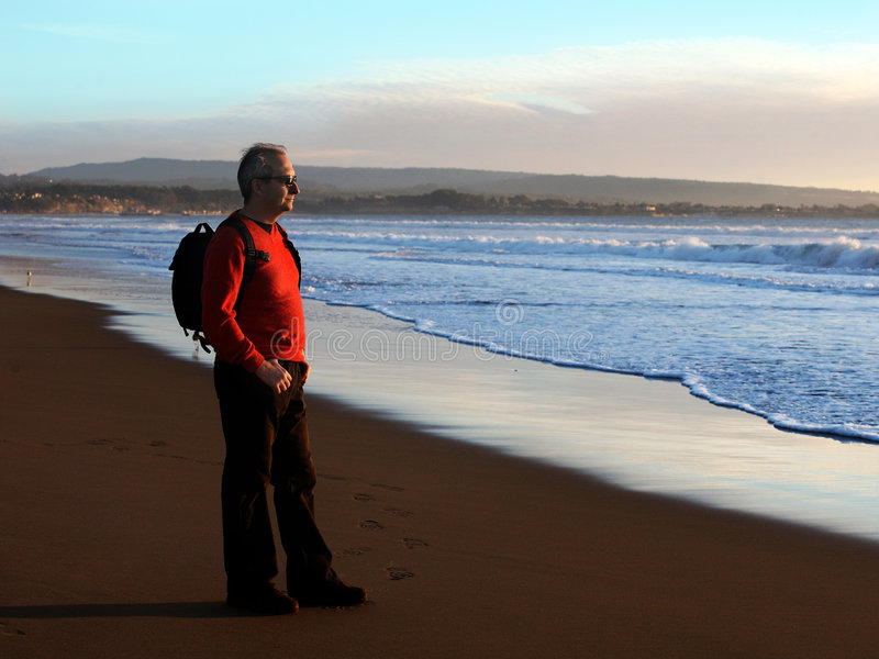 Man enjoying sunset by the ocean royalty free stock photography