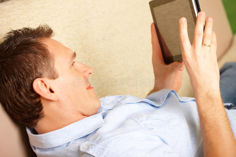 Download Man enjoying tablet stock photo. Image of lifestyle, couch - 24317848