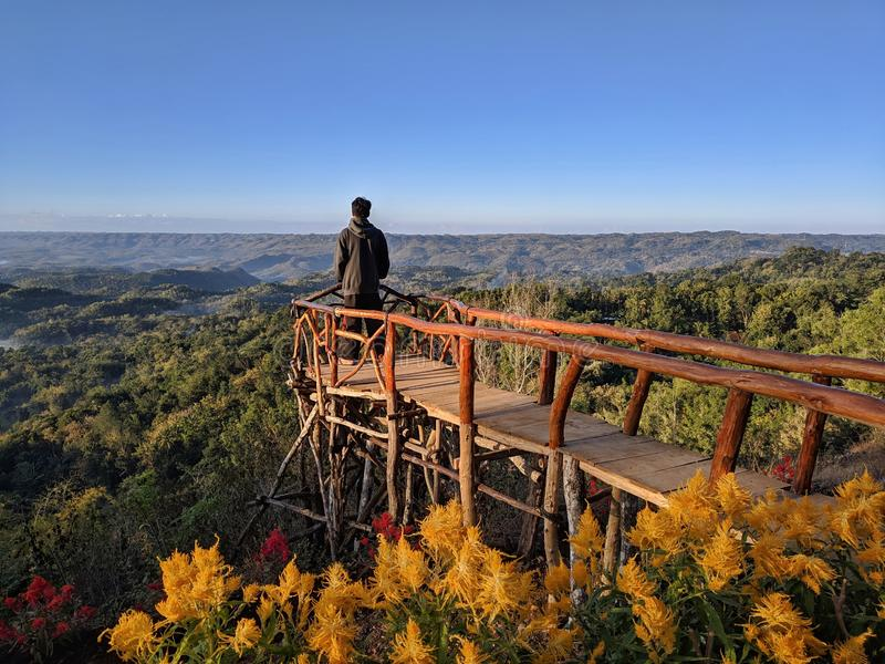 A man is enjoying the view from the hill.  stock photo