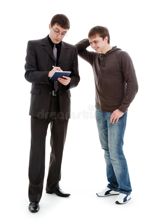 Man enjoys looking at the notebook. A young man enjoys looking at the notebook in which another man wrote, isolated on a white background royalty free stock image