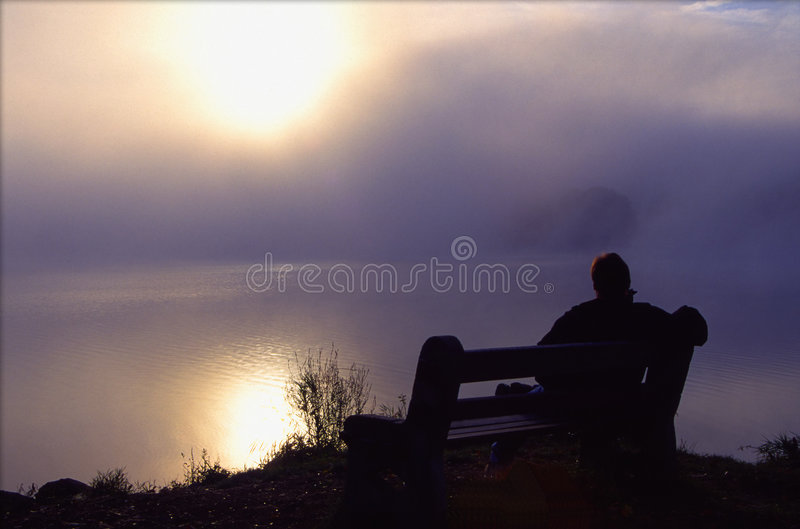 Man Enjoys Peaceful Morning by the Lake royalty free stock photography