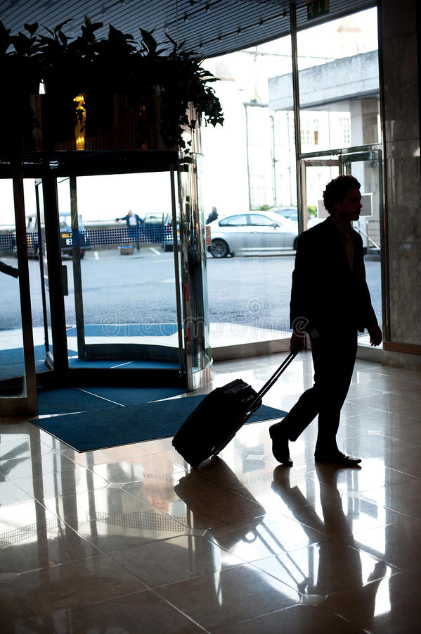 Man Entering Hotel Lobby With His Luggage Stock Photos