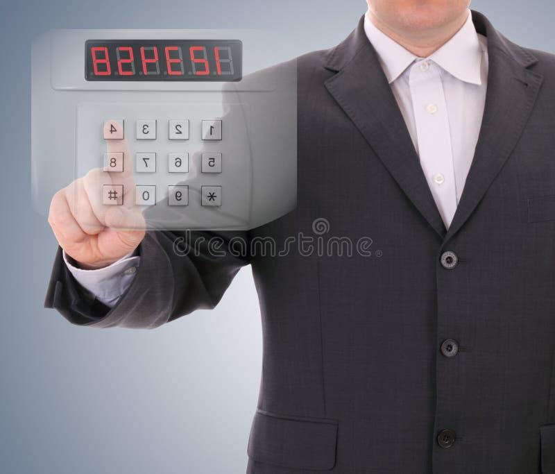 Man entering safe code. Futuristic via keyboard stock photos