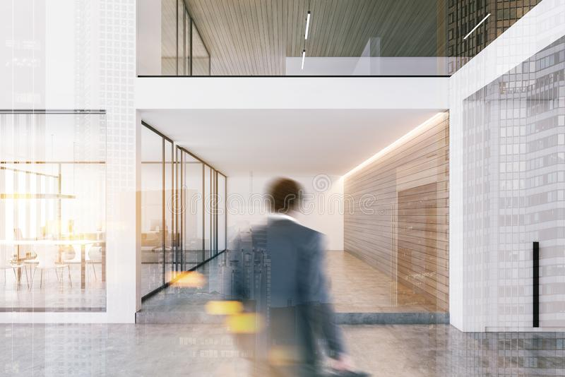 Man entering white open space office royalty free stock images