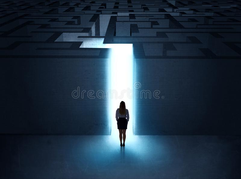 Man at the entrance to a maze. A businessman at the entrance to a maze royalty free stock images