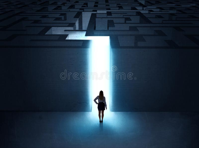 Man at the entrance to a maze. A businessman at the entrance to a maze stock images