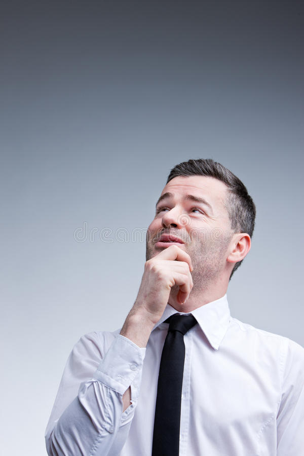 Man evaluating problems and solutions royalty free stock photo