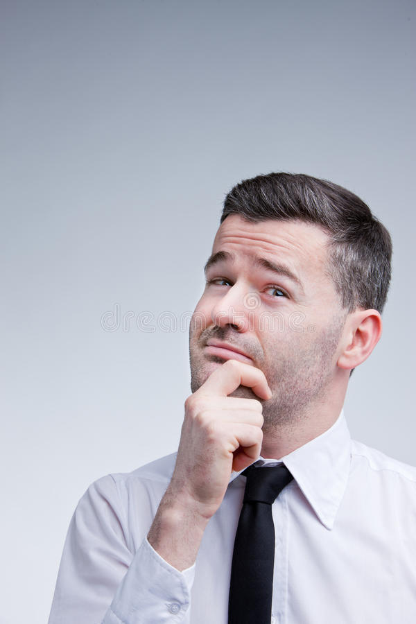 Man evaluating problems and solutions stock image